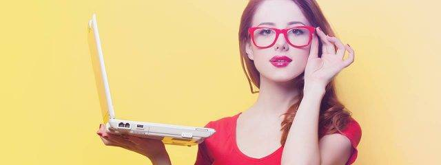 Optometrist, woman holding a laptop in Jacksonville, Florida