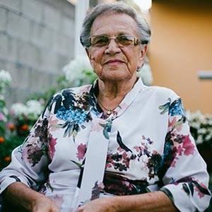 optometrist, older woman with hoop earings, wearing scleral lenses
