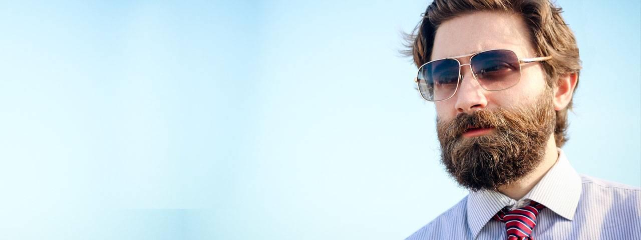 Eye doctor, bearded man wearing designer sunglasses in North Miami Beach, FL