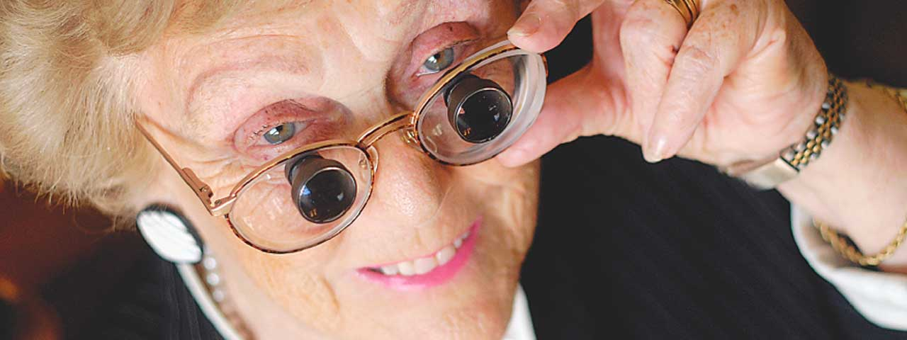 Eye doctor, senior woman wearing low vision goggles in North Miami Beach, FL