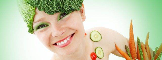 Eye doctor, smiling woman covered in vegetables in Fort Collins, CO