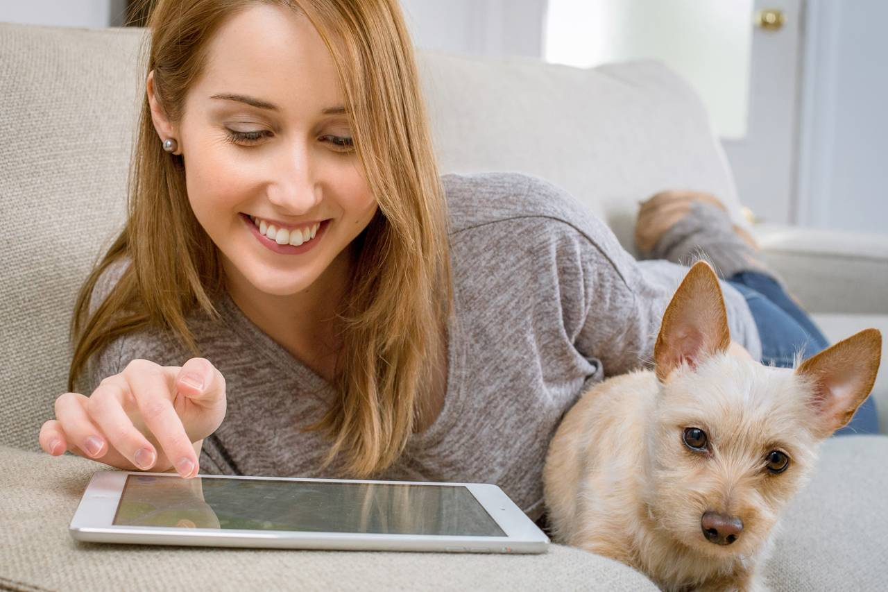 Happy-Girl-using-Ipad-1280-x-853