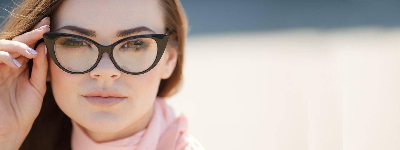 Woma wearing designer eyeglasses in Calgary, AB