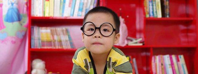 Eye doctor, boy wearing eyeglasses in Toronto, ON