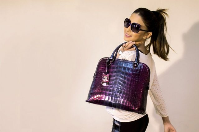 Woman carrying purple tote bag