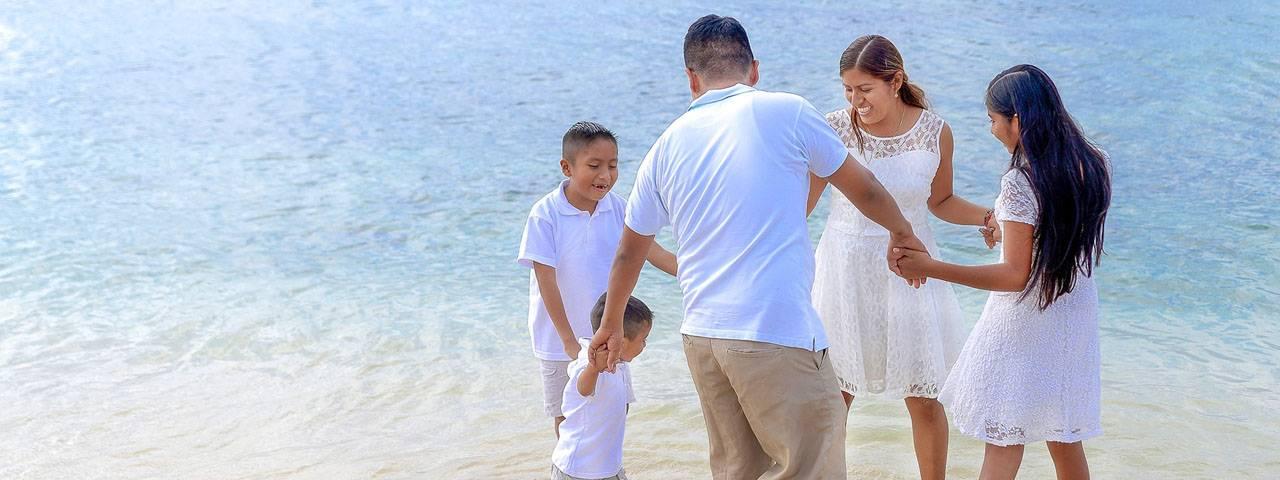 Family Dancing on Beach 1280×480