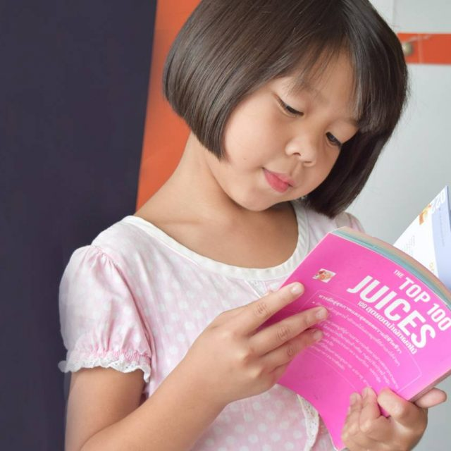 Asian-Girl-Reading-Book-1280x853-640x640