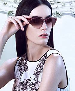 Model wearing BCBG sunglasses
