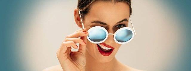 Eye doctor, woman wearing sunglasses in Cromwell, CT