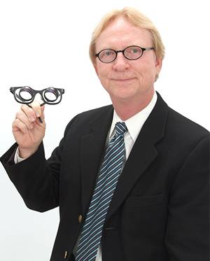 Dr. Chism holding glasses