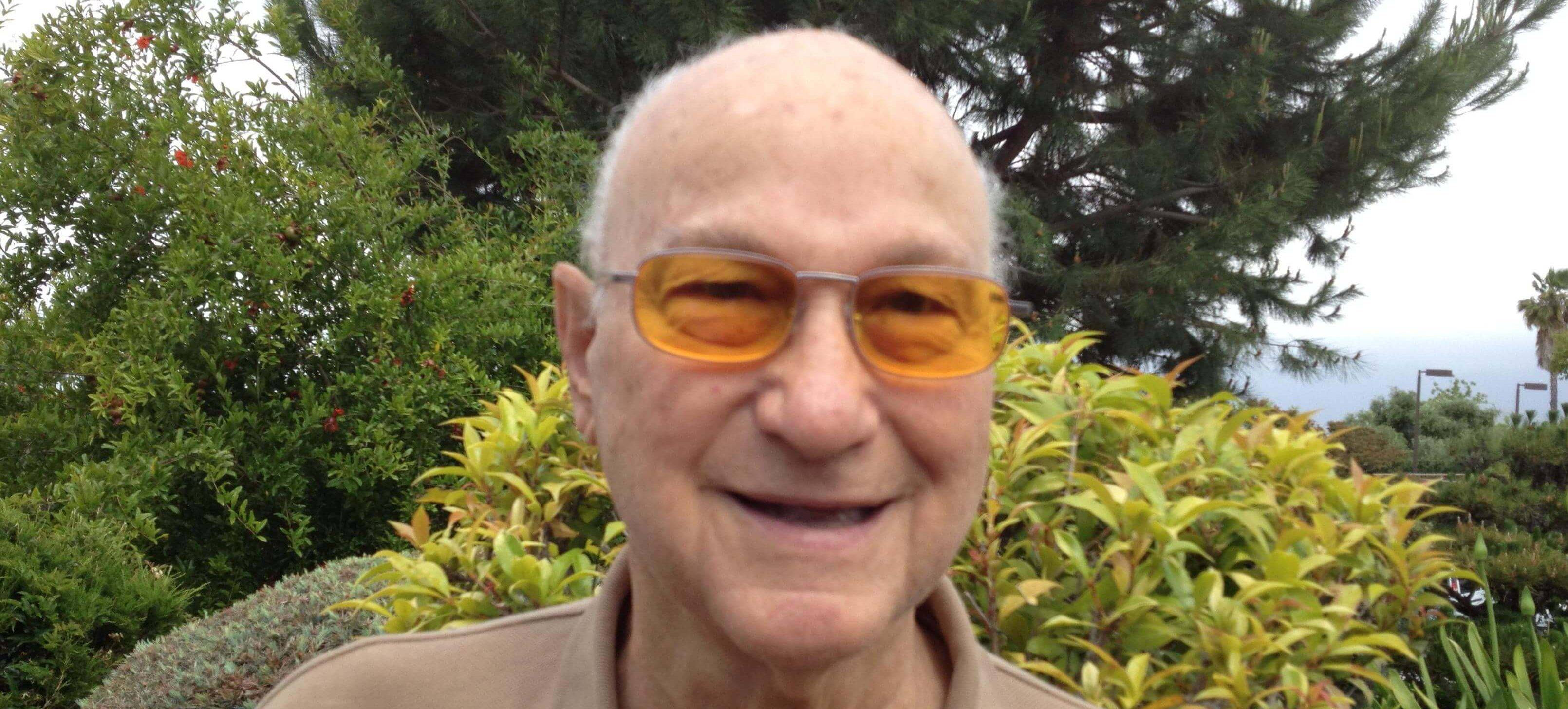 Senior wearing low vision glasses in Denver, CO