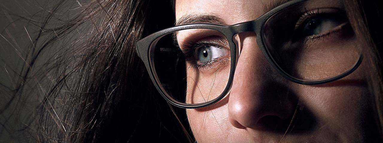 Eye doctor, woman wearing eyeglasses with Nikon lenses in Kamloops, BC