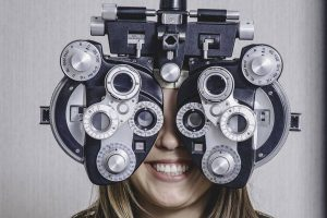 Happy woman, having eye exam in Wildomar