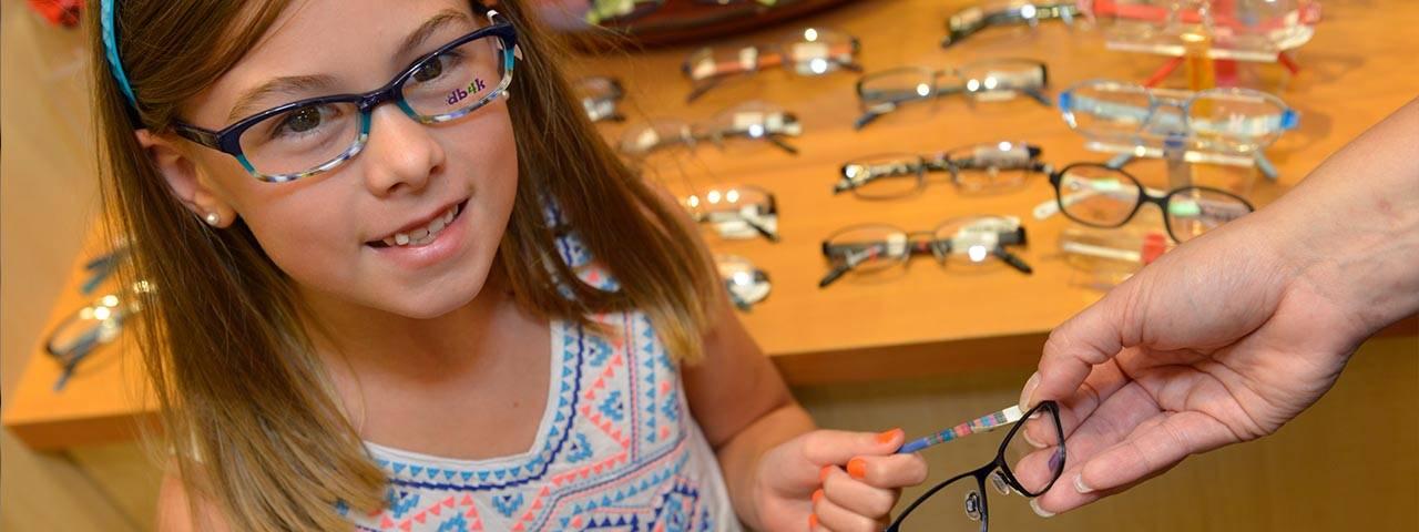 Girl trying on glasses, children's eyewear in Baton Rouge, LA