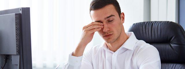 Optometrist, man rubbing eyes in Springs, CO