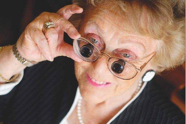 Woman in E-Scoop glasses for Low Vision from Macular Degeneration