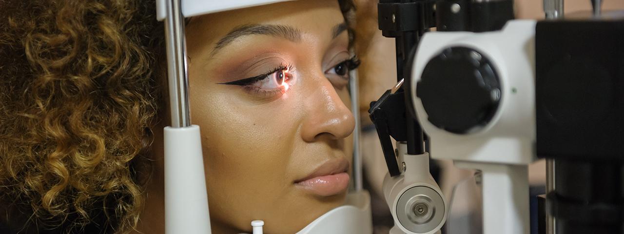 Woman taking an eye exam in Ogden, ON