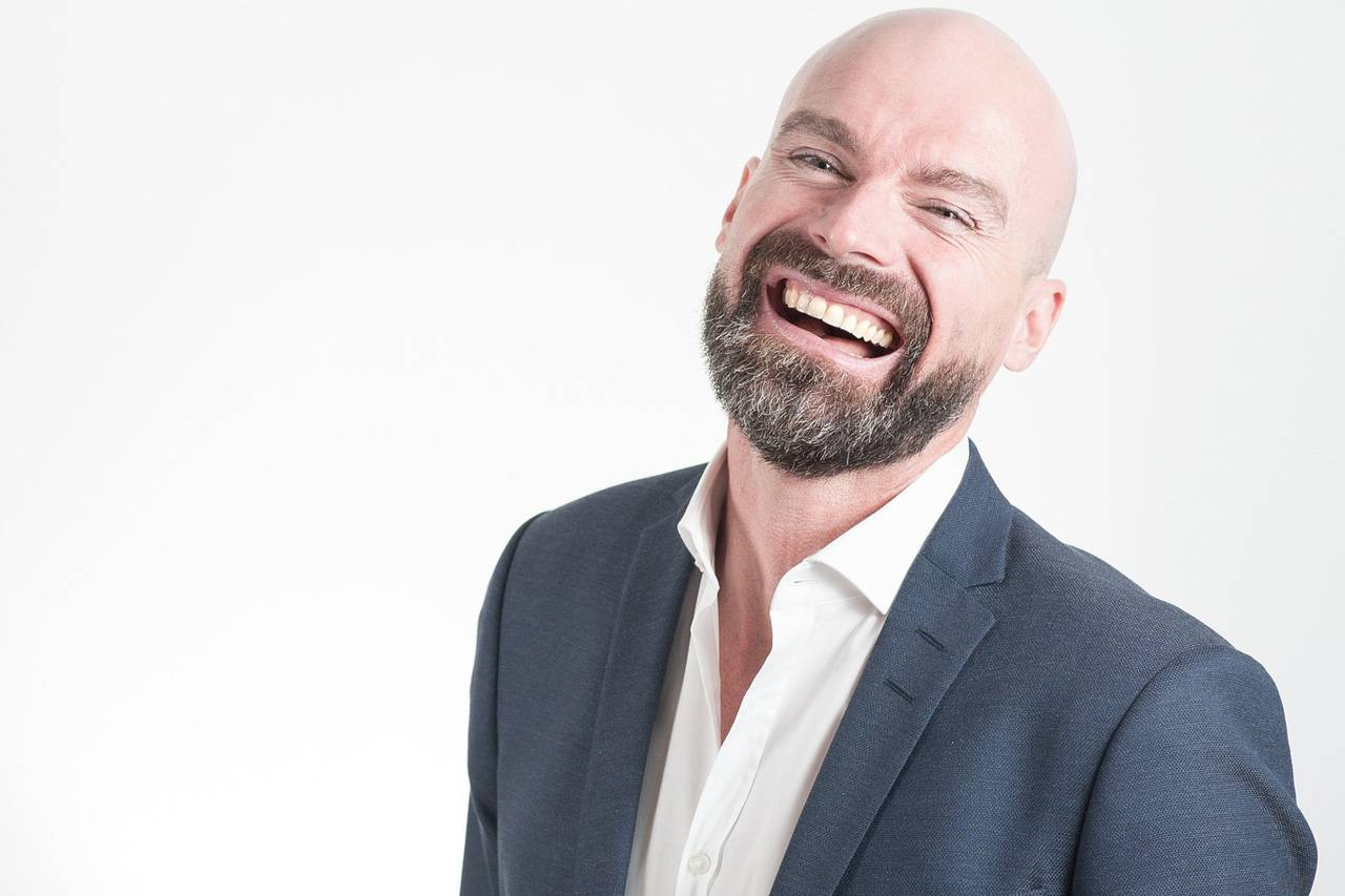 Man Wearing Suit Laughing 1280x853