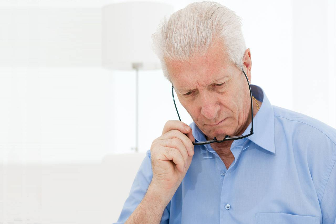 senior man, difficulty reading because of Low Vision