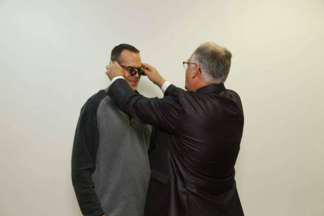 Dr. Ashcraft with low vision patient