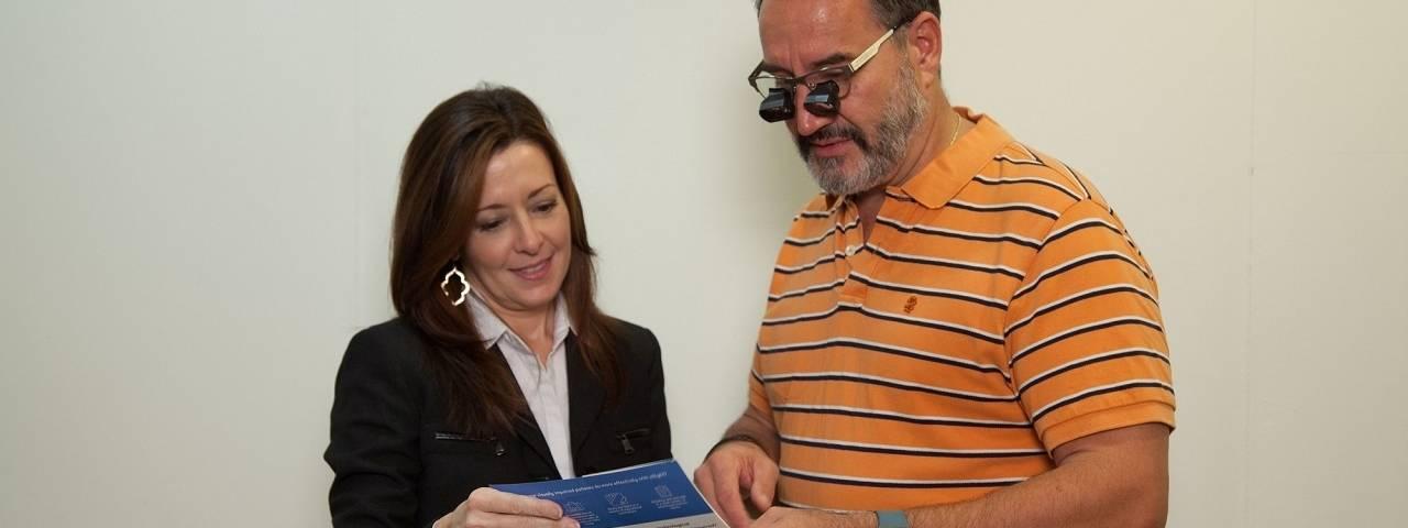 Dr. Douglas helping low vision patient