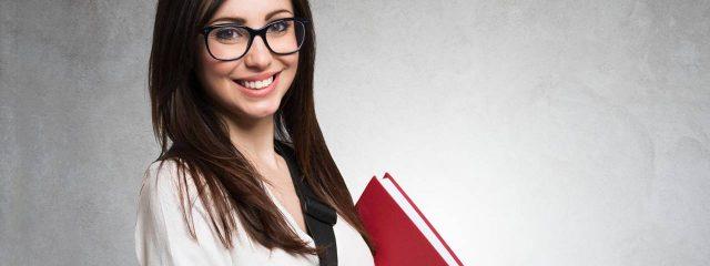 Eye doctor, girl smiling wearing eyeglases in Belmont, CA