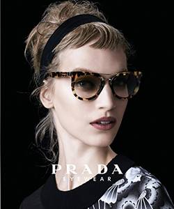 Model wearing Prada glasses