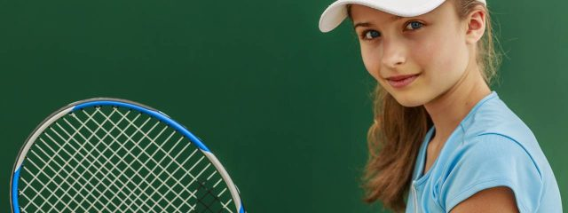 Eye doctor, girl holding a tennis racket in Fort Collins, CO