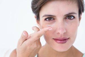Pretty woman applying contact lens - Optometrist - Paramus, NJ