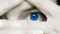 blue eye between fingers