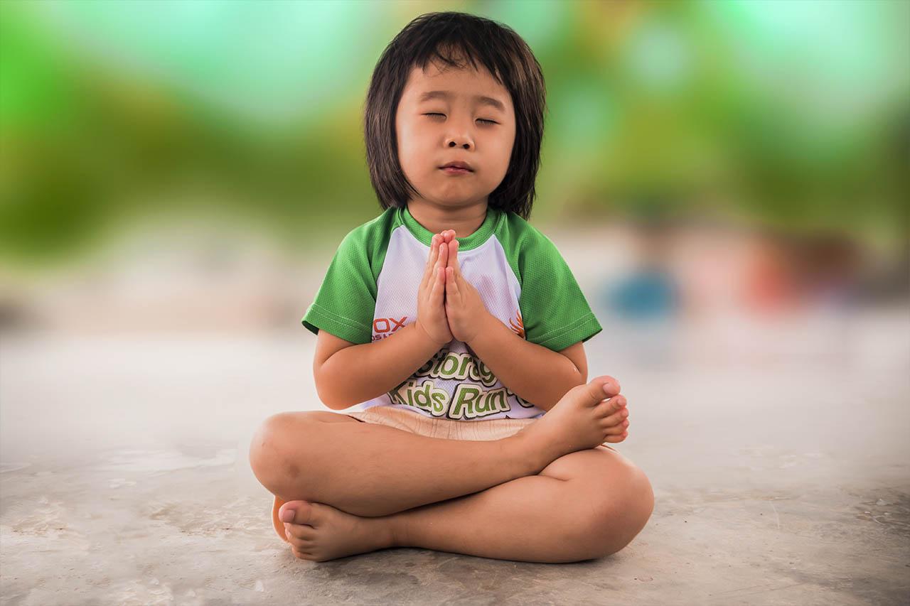 little asian child meditating