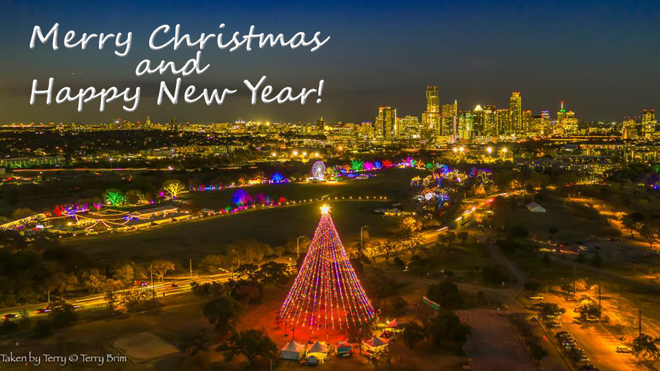 Photo of Zilker Park Christmas Tree and Trai of Lights as seen by drone at night.