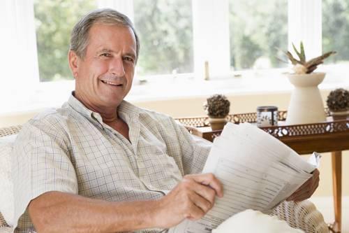 man_reading_newspaper