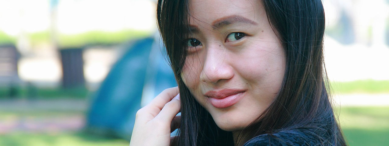 Asian girl wearing contact lenses in New York and Roslyn, NY