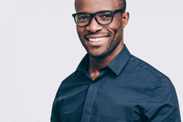 Man Smiling Black Glasses 1280x853 640x427