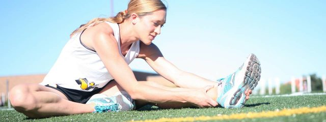 sports female runner stretching 1280x480 640x240