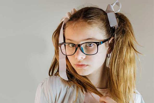 girl wearing glasses with myopia