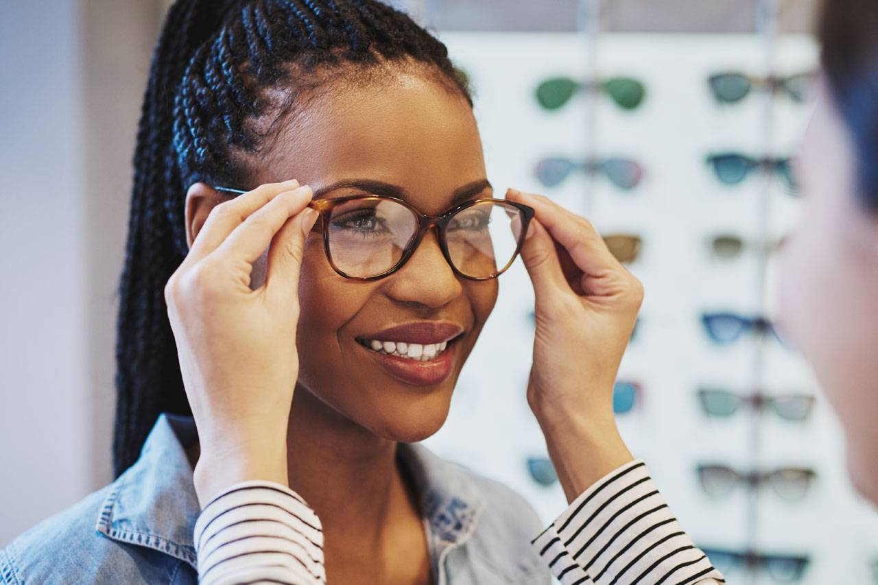 African Woman Trying on Glasses 1280x853