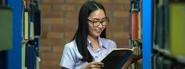 Eye doctor, asian girl in the library in Fairhope, Alabama