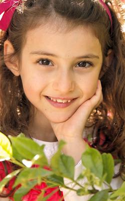 close-up-of-brown-eyed-brunette-child-vertical-slide.png