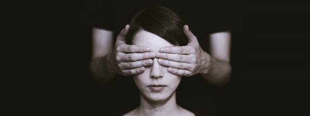 woman w hands covering eyes 640x240