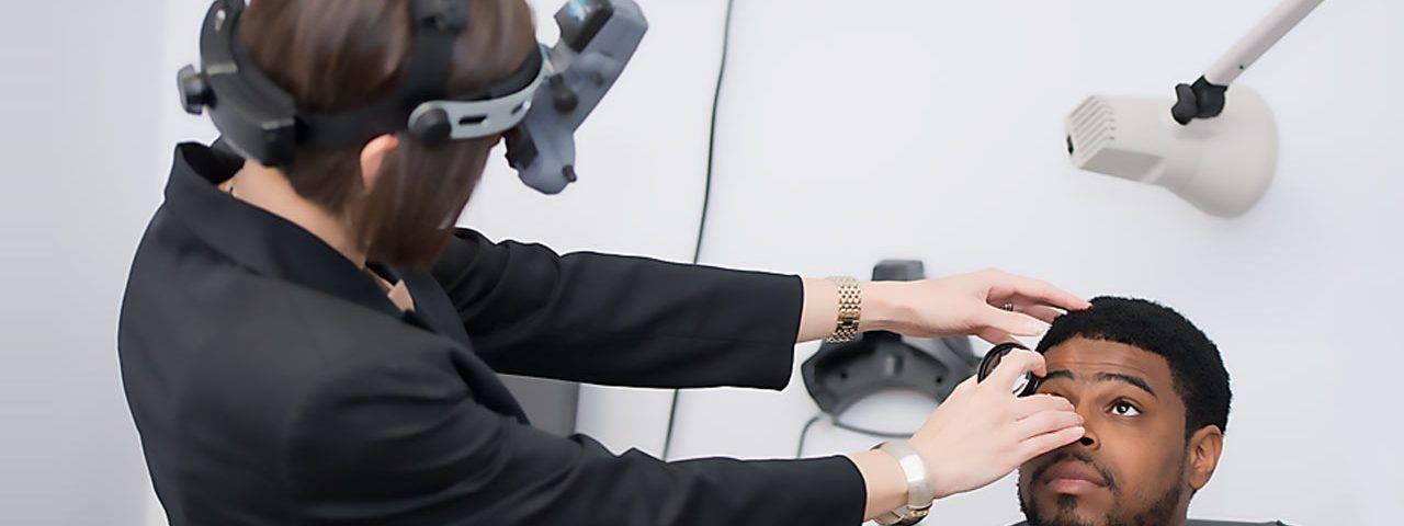Optometrist, man receiving an eye exam in Mentor, OH