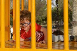 boy on playground climber