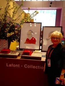 Photo of Denise in front of Lafont- Collection table.