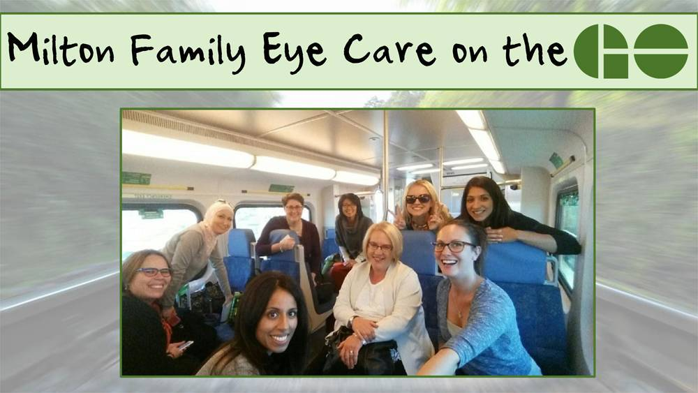 Milton Family Eye Care on the Go. Photo of team smiling on the Go train.