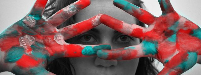 Eye doctor, woman hands colored in red and blue in Costa Mesa, CA