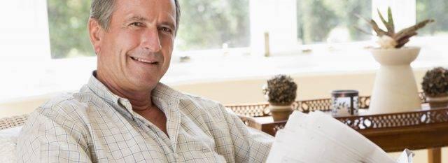 Eye doctor, senior man reading a newspaper in Costa Mesa, CA