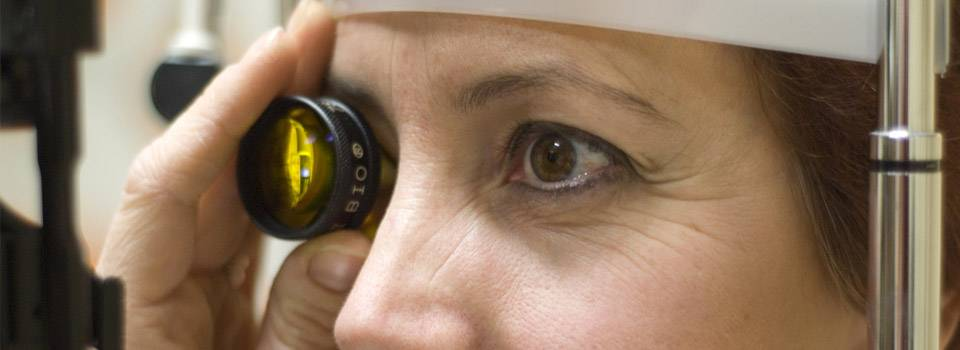 Eye doctor, woman at a diabetic eye exam in Fredericton & Minto, NB