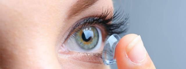 Eye care, woman putting contact lens in San Jose, CA