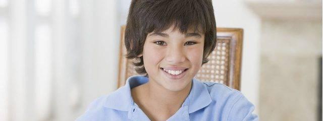 Eye doctor, asian boy smiling in Winnipeg, Manitoba